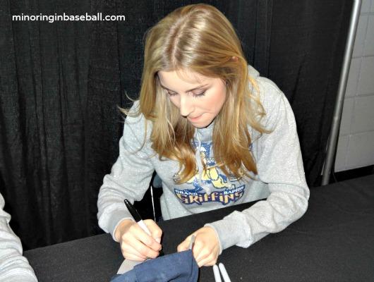 Stephanie signing Brian's Whitecaps hat!