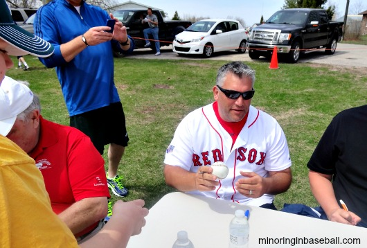 Doug Mirabelli signs some baseballs for the kids