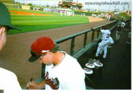 Lance Parrish signs some cards for the kids while managing the Loons in 2007
