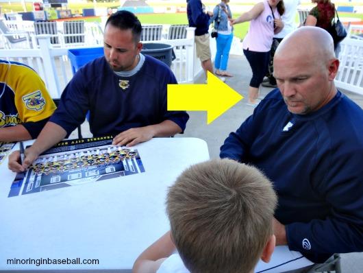 Former Beach Bums manager Gregg Langbehn signs a baseball for Brian last season