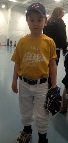 Inside or outside, Brian is happy baseball has started. He insisted on wearing his full uniform for practice!