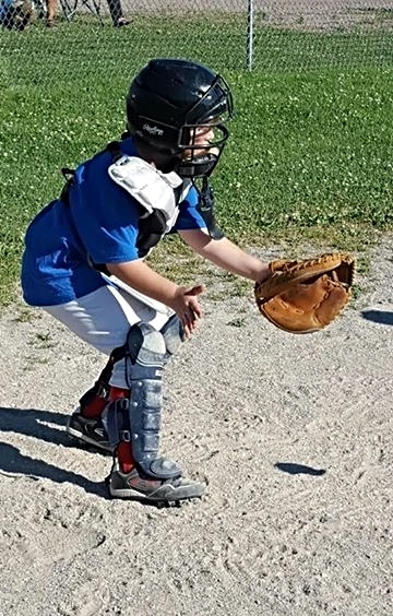 Brian busy behind the plate